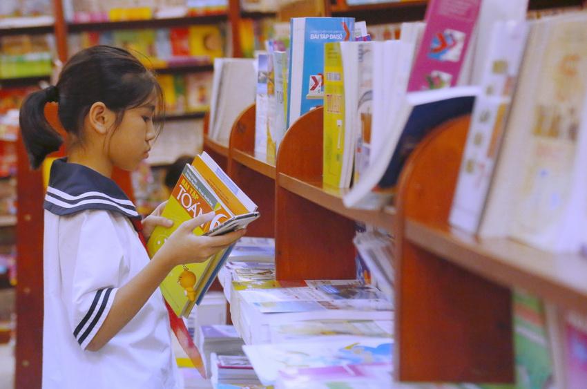 """""""SGK cụ thể hóa các yêu cầu của chương trình giáo dục phổ thông về nội dung giáo dục, yêu cầu về phẩm chất và năng lực học sinh""""... - Nghị quyết 88 của Quốc hội. Nguồn ảnh: giaoducthoidai.vn"""